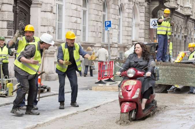 "In one of the more expected moments Susan Cooper (Melissa McCarthy) tries to get her man but gets oh-so stuck in cement in ""Spy."""